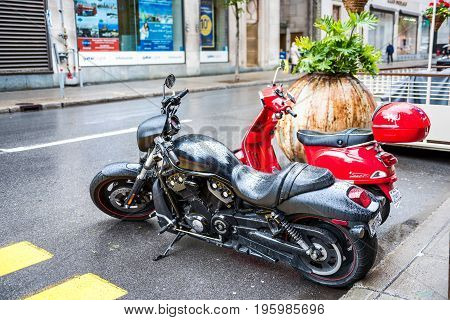Montreal Canada - May 26 2017: Harley Davidson motorcycle wet with rain drops parked on street in downtown city in Quebec region