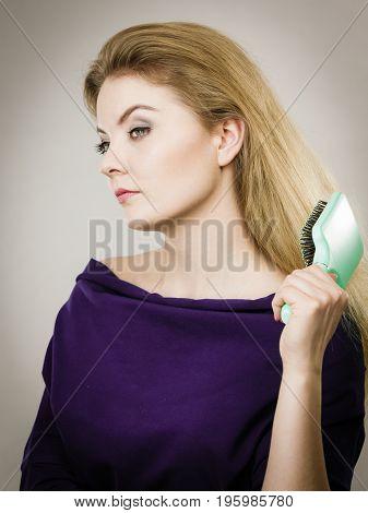 Woman Brushing Her Long Hair With Brush