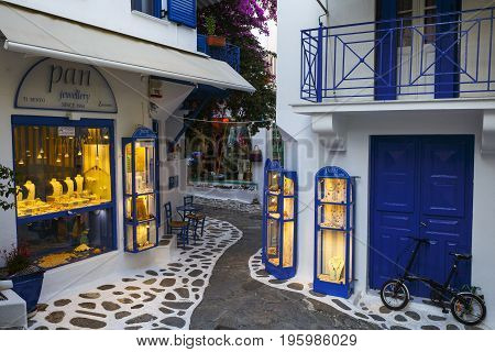 SKIATHOS, GREECE - JUNE 18, 2017: Shops in the old town of Skiathos in Sporades, Greece on June 18, 2017.