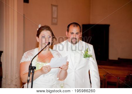 Bride And Groom Speaking At The Church During A Wedding Ceremony