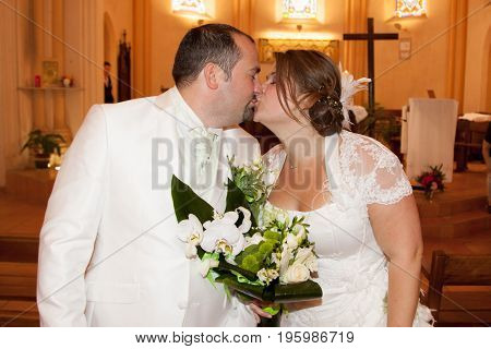 Beautiful Woman Bride And Handsome Man Groom At Church During Wedding