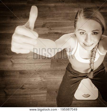 Teenage Woman On Bathroom Scale Machine