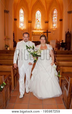 Bride And Groom Holding Hands At The Church During A Wedding Ceremony