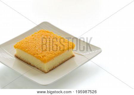 Golden egg strips topping on butter cake or Foi Thong cake on plate