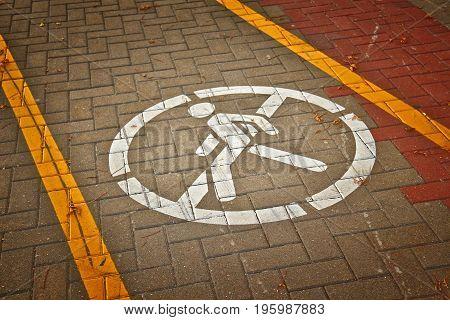 No passage sign drawn on asphalt road on bike path