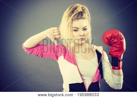 Woman Wearing Boxing Gloves Showing Thumb Down