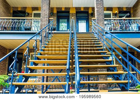 Montreal Canada - May 27 2017: Two blue staircases or steps to apartment flats in Plateau neighborhood during summer during sunny day in city in Quebec region