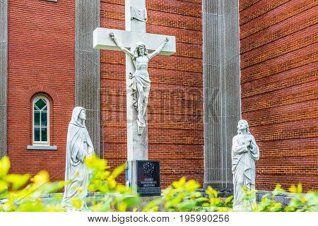 Montreal Canada - May 27 2017: Statue of Jesus Christ crucifixion at Notre Dame de la Defense church in Little Italy Plateau neighborhood in city in Quebec region