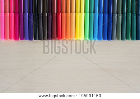 Back to school supplies stationery colorful pens accessories on wooden background Top view flat