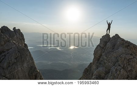 Victory happiness at the summit & success concept on peak