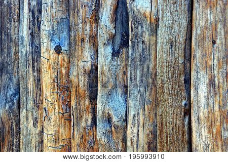 Gray texture of old wooden boards of a rural fence