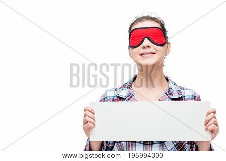 A Woman With A Mask On The Eyes Dressed In Pajamas, Holding A Poster On A White Background