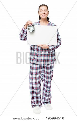 Beautiful Woman In Pajamas With A Poster And An Alarm Clock Before Going To Bed On A White Backgroun