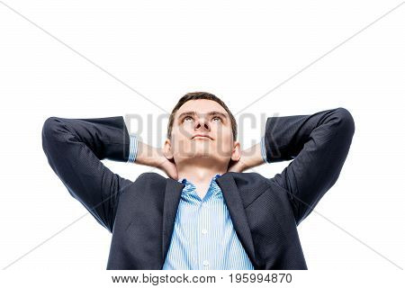 Portrait Of A Dreaming Young Businessman About A Big Successful Business On A White Background
