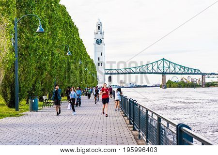 Montreal, Canada - May 27, 2017: Old Port Area With People Walking And Running On Boulevard Sidewalk