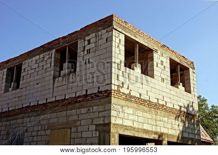 Part of the construction of a house of white brick