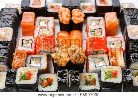 Sushi and rolls pattern background, japanese restaurant delivery top view. Salmon, unagi, california and other colorful healthy meals
