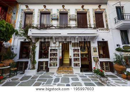 SKIATHOS, GREECE - JUNE 18, 2017: Art gallery in the old town of Skiathos in Sporades, Greece on June 18, 2017.
