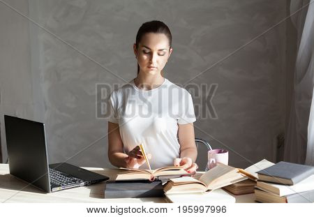 girl is preparing for the exam reading book works