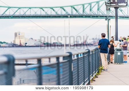 Montreal, Canada - May 27, 2017: Old Port Area With People Walking On Sidewalk In City In Quebec Reg
