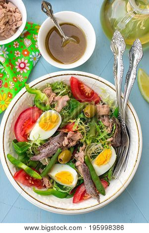 French traditional salad salade niçoise with tuna vegetables and anchovy