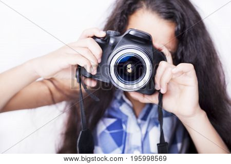 Cute Brunette Little Girl Holding An Photo Camera, Isolated On White Background