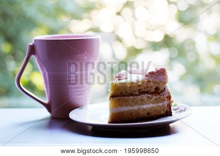 Pink Cup Of Tea And Piece Of Cake