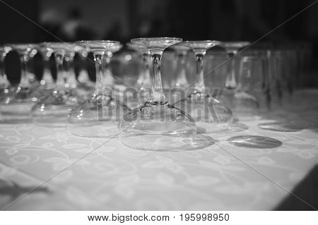 Rows of empty wine glasses. black and white photo
