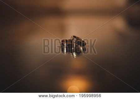 Engagement rings Wedding rings on background indoor