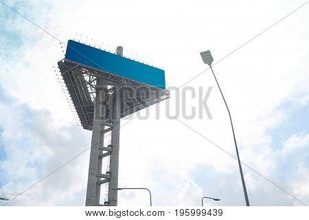 Blank billboard against blue cloudy sky.Empty screen against blue cloudy sky.