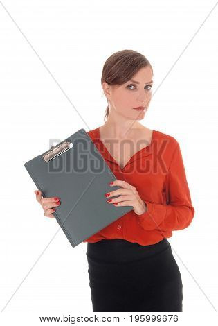 A gorgeous young business woman standing in a red blouse holding a green folder in her hand isolated for white background.