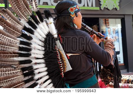 Reading, Uk - June 17Th 2017:native South American Flute Player In Traditional Costume With Feathers
