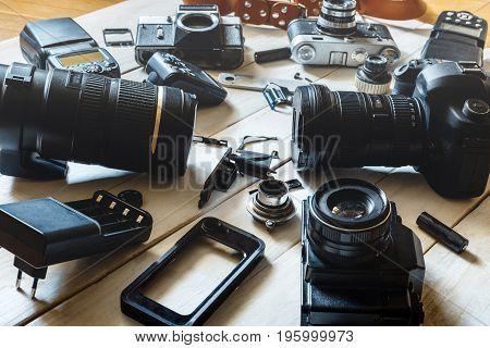 Vintage Film Camera DSLR Camera And Smartphone Technology Development Concept. Closeup