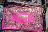Embroidered little bag for holy Jewish books for sale at Carmel Market, popular marketplace in Tel-Aviv. Israel poster