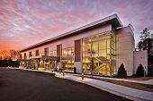 Generic Modern Stylish Office Executive Retail Building Exterior With Stone and Metal walls and Large Glass Windows And Brick Accents poster