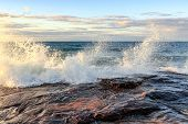 Storm surge drives crashing waves over sandstone rock at Pictured Rocks National Lakeshore in the Upper Peninsula of Michigan in Munising poster