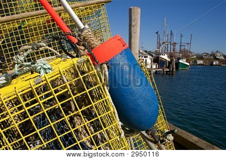 Colorful Lobster Traps, Buoys, And Fishing Boats
