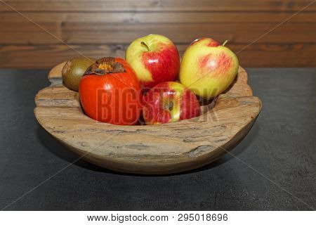 Scene Of Fruits In A Wooden Bowl On Dark Table. Torfhaus, Germany