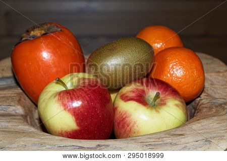Close-up Of Various Fruits In A Wooden Bowl. Torfhaus, Germany