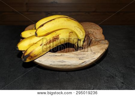 Ripe Yellow Bananas In A Wooden Bowl. Torfhaus, Germany