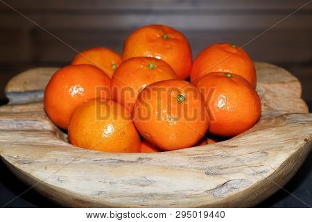 Pile Of Tangerines In A Wooden Bowl. Torfhaus, Germany