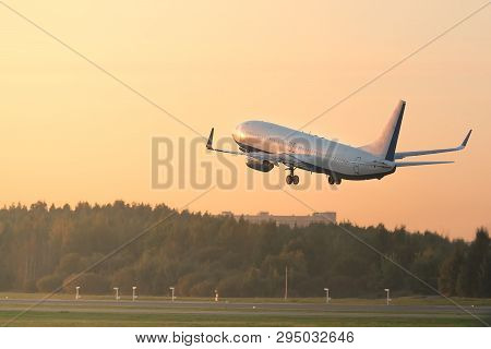 Airplane Taking Off On Sunset Side View, Soft Sunset Light. Plane Fly Up At Sunny Summer Day/ Passen