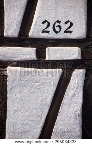 The Beam Construction And The Facade Of A Half-timbered House Via Close-up With House Number.