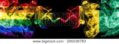 Gay Vs Guinea, Guinean Smoke Flags Placed Side By Side. Thick Colored Silky Smoke Flags Of Pride And