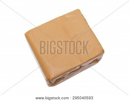 Brown Cheese Isolated On White Background. Popular Cheese In Scandinavia. Most Iconic Foodstuffs In