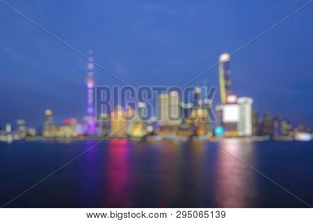 Out Of Focus Of  Shanghai City Skyline Pudong Side Looking Through Huangpu River On Twilight Time. S
