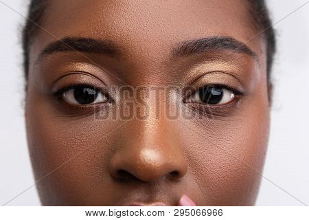 Dark-skinned Young Woman With Nice Golden Eyeshades