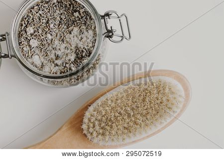 Wooden Brush With Natural Bristle For Body Massage And A Jar With Lavender Scrub. Spa And Anticellul