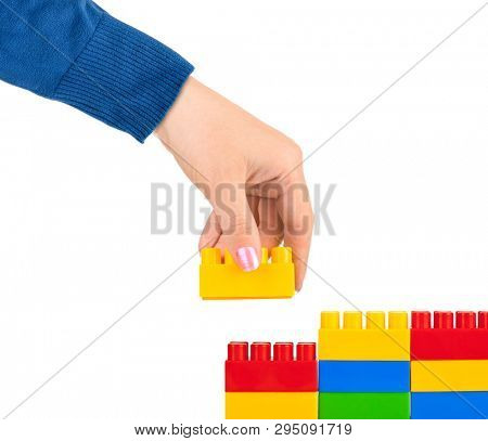 Hand and toy wall isolated on white background poster