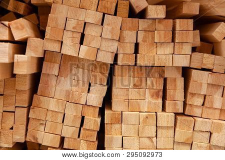 Wall Of Wooden Beams, Texture Close-up. Close Up Photo Of Stack Wood Beams In The Factory